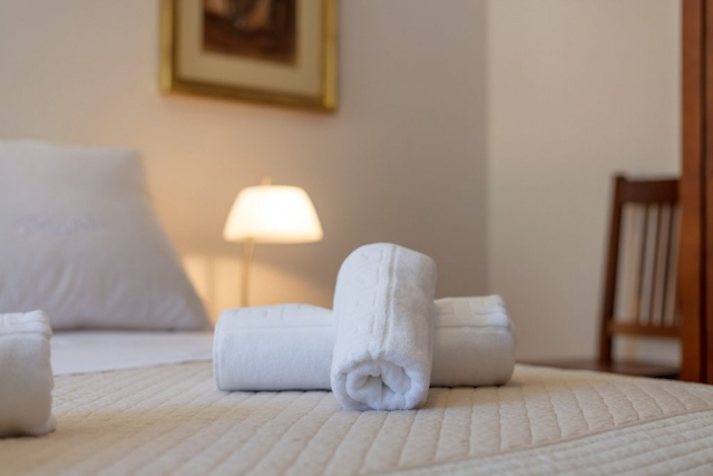 Decorative towels on the bed in the Villa Roglic