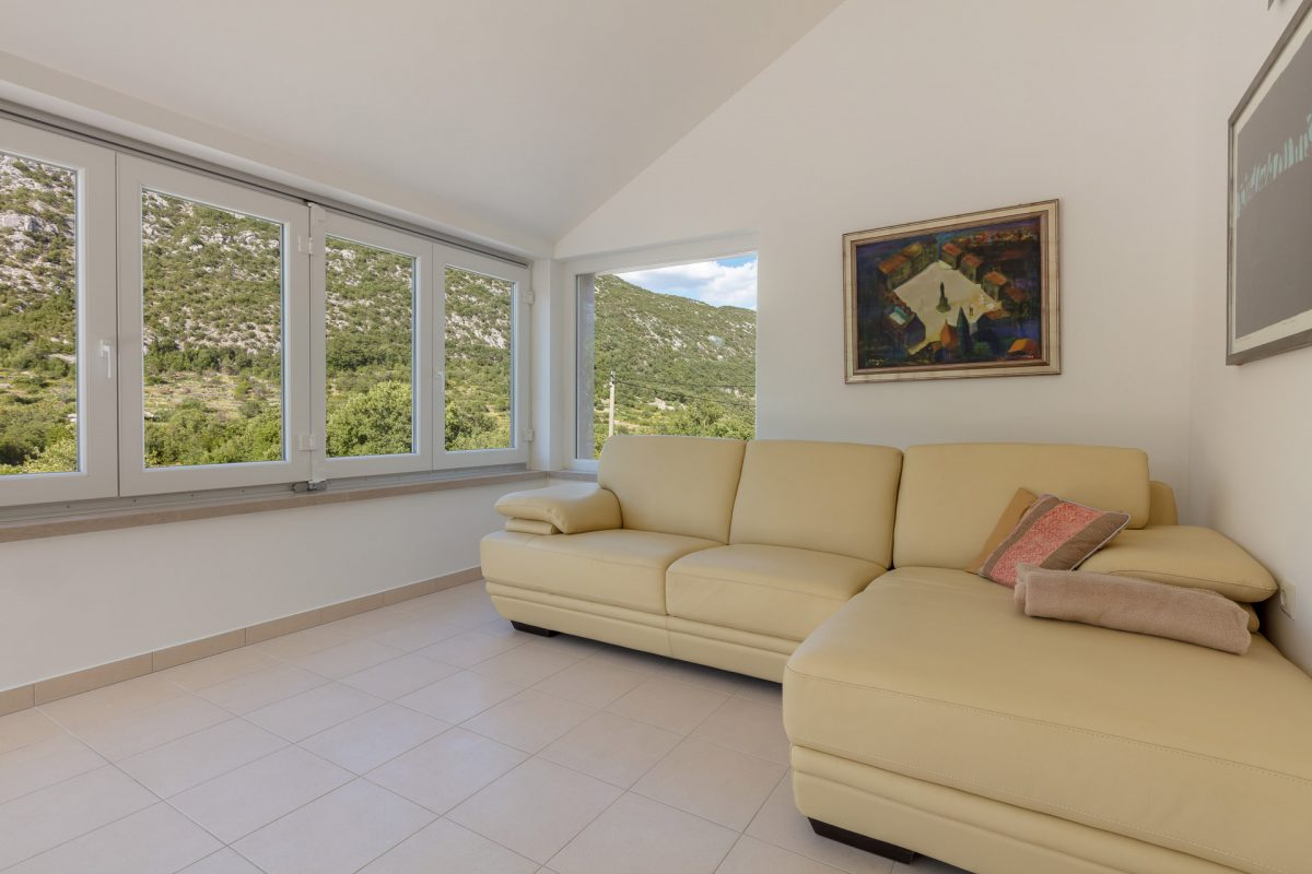 Comfortable sofa at the living room in the Villa Roglic with the view on beautiful mountain Biokovo