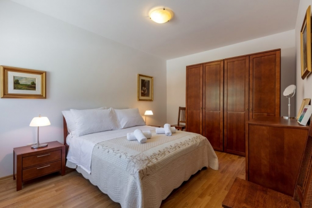 Traditional styled double bedded room in the Villa Roglic